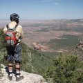 Mountain biker enjoying the views from the Rainbow Rim trail